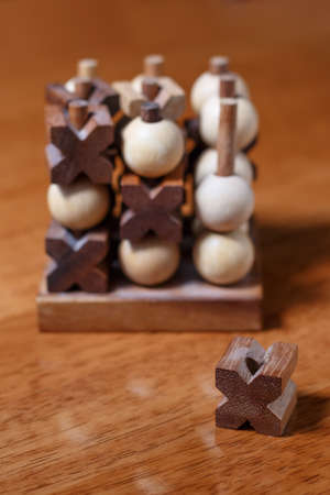 tic-tac-toe or noughts and crosses game in wooden stick standing Stock Photo