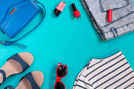 stuff: Summer female clothing in sea theme on bright background, copyspace