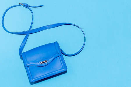 Blue purse on a colorful blue background Stock Photo
