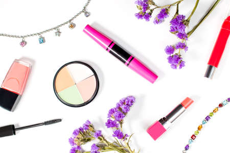 Make up products and jewelry on a white background, overhead view Stock Photo