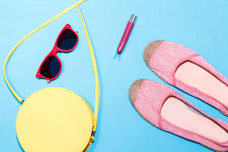 Colorful stylish female summer accessories collection on blue background
