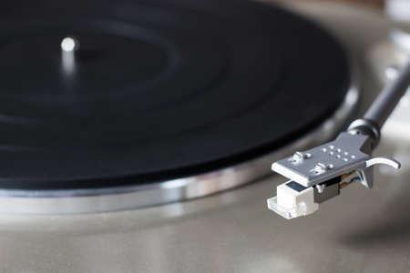 Vinyl record spinning close up, overhead