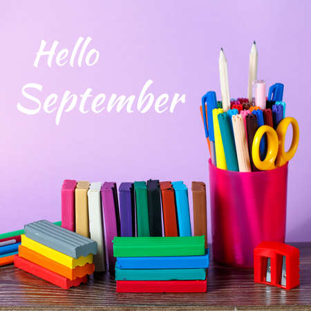 Hello September greeting card with school supplies in background