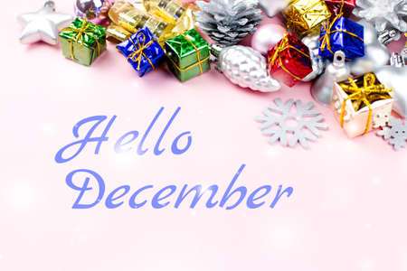 Hello December Greeting Card With Colorful Christmas Ornaments, Presents In  The Background Photo
