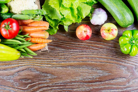 Various fresh vegetables on a wooden background, copy space. Healthy eating concept. Stock Photo
