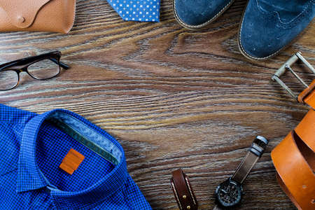 Mens casual outfit with man clothing and accessories on brown wooden background