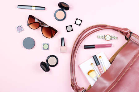 Fashion woman feminine flat lay with beauty products and accessories on pink background, copy space,