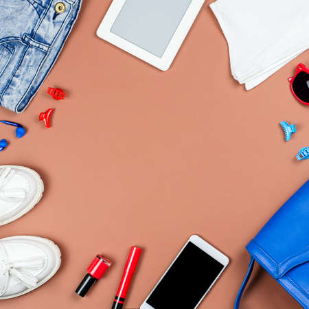 Woman accessories and clothing in red and blue colors on a neutral background