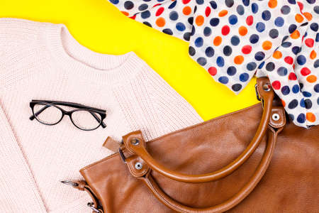 Stylish woman winter clothing and accessories on bright background, flat lay