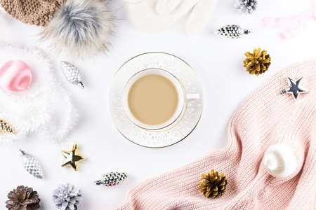 Christmas fashion composition with winter clothes, hot drink, christmas ornaments. Flat lay