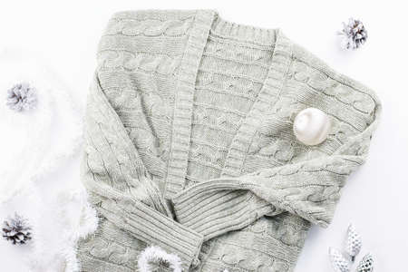 Winter fashion concept flat lay. Warm, cozy winter clothing, Christmas decorations on white background