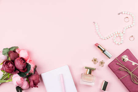 Fashion collection with accessories, flowers, cosmetics and jewelry on pink background, copyspace. Womens Day concept 스톡 콘텐츠