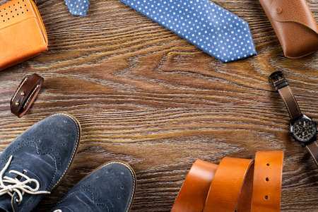 Mens shoes and accessories flat lay on a wooden background. Copy space Stock Photo