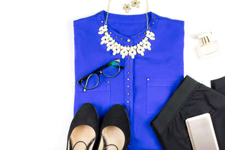 Female smart casual style clothing and accessories -purple shirt, black pants, fashion accessories.