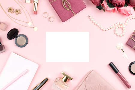 Woman fashion accessories, flowers, cosmetics and jewelry on pink background, copyspace. Womens Day concept
