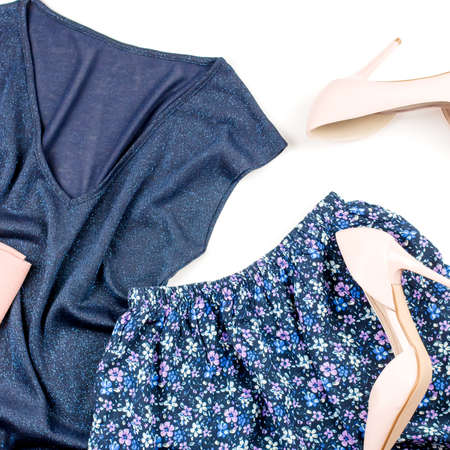 Summer casual style modern woman clothes and accessories - blue top and skirt, pink pumps with clutch. Top view