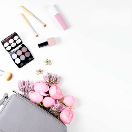 Beauty blog concept flat lay. Fashion accessories, flowers, and cosmetics. Top view Stock fotó