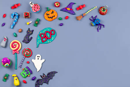 Halloween background with decorations. Black cat, bats, witches hat and broomstick with orange pumpkins on white background.