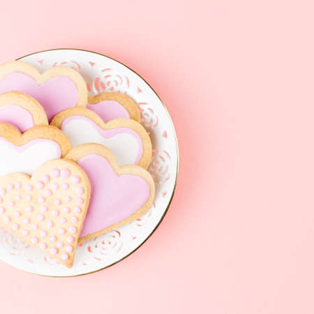 Valentines day cookies close up on pink background. Stock Photo