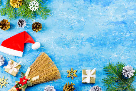 Blue Christmas background with fir branches, red giftboxes, silver and golden decorations, copy space Stock Photo