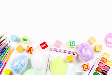 Child creativity concept flat lay. Various artistic tools for children on white desktop