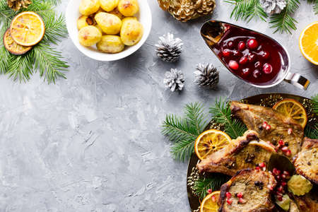 Delicious Christmas meal with roasted meat steak, Christmas Wreath salad, baked potato, grilled vegetables, cranberry sauce. Stok Fotoğraf