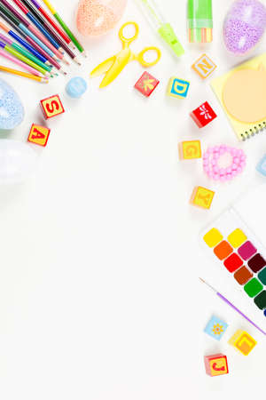 Child creativity concept flat lay. Various artistic tools for children on white desktop. Stock Photo