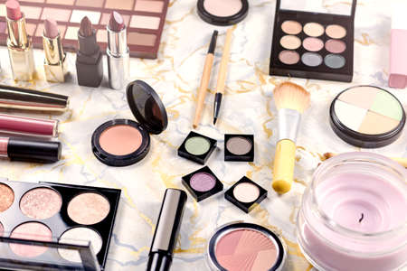 Various makeup products on table, flat design. Woman cosmetic essentials