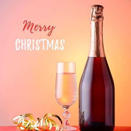 Christmas card with champagne glass, bottle, carnival mask, christmas ornaments, fir tree branch closeup