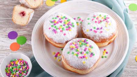 Colorful carnival donuts, holiday celebration baking, top view