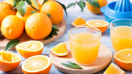 Fruit squeezer and ripe fresh oranges on blue wooden table top, fresh orange juice making, overhead