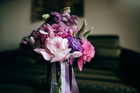 Beautiful purple wedding bouquet with fresh lilacs, peonies, tulips