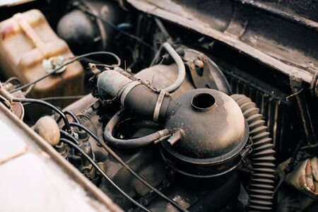 Old rusty gasoline engine in old car