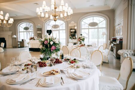 Restaurant table with food. Catering service. Wedding celebration, decoration. Dinner time, lunch.