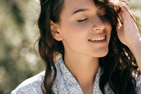 Young happy woman closed her eyes and smiles Imagens