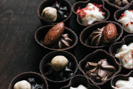 Delicious chocolates with almonds and cinnamon. Sweets Фото со стока