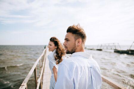 Man and woman walking on the sea pier. Summer vacation Zdjęcie Seryjne