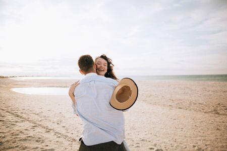 Couple in love hugging at sea. Honeymoon and vacation at sea
