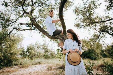 Happy young couple in the national park. Travel concept Zdjęcie Seryjne