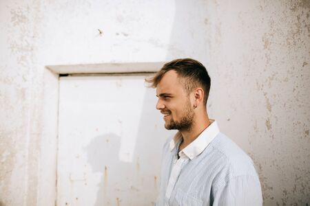 Portrait of a young handsome smiling man. Lifestyle portrait