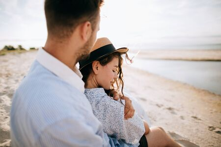 Summer vacation on the island. Young couple in love hugging on the beach