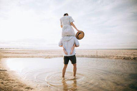 Beach relaxing vacation travel tourists couple walking on beach. Summer holidays destination. Zdjęcie Seryjne