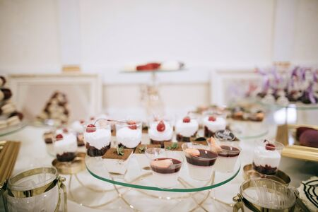 Dessert table with sweets at a wedding ceremony in a restaurant