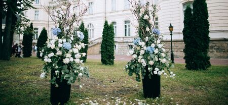 Wedding ceremony in the castle with beautiful arch decorated with fresh flowers