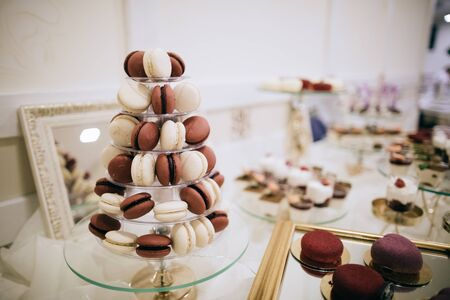 Dessert table at the wedding reception with red and white macaroons