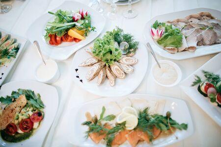 salad and other food on tableat restaurant Zdjęcie Seryjne