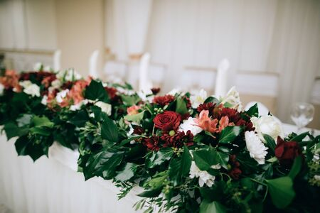 Bridal table decor with fresh flowers in the restaurant