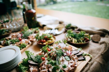 Various meat snacks on the buffet table, catering service outdoor