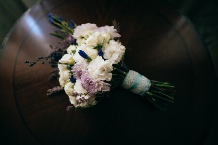 beautiful wedding bouquet of flowers on the wooden table