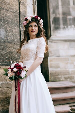 Beautiful bride portrait outdoors in old city. Wedding concept
